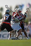 Carson,CA 08/13/06 - Todd Eichelberger splits two Denver Outlaw defenders at the top of the box during the Los Angeles Riptide's must win game to advance to a post season berth, against the Denver Outlaws  Photo Dirk Dewachter / Cal Sport Media