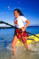 Young woman finishing an ocean canoe workout