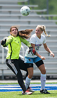 NWA Democrat-Gazette/CHARLIE KAIJO Southside High School goalkeeper Melanie Rice (1) and Maddison Hagen (15) look to block a shot at the goal during the semifinals of the 7A Girls State Soccer Tournament, Saturday, May 12, 2018 at Whitey Smith Stadium at Rogers High School in Rogers. Rogers advanced to the finals when midfielder Skylurr Patrick (3) scored both of Rogers' goals defeating Southside High School, 2-1.
