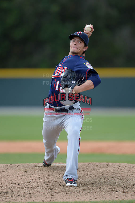 Minnesota Twins pitcher Dereck Rodriguez (12) during a minor league spring training game against the Baltimore Orioles on March 20, 2014 at the Buck O'Neil Complex in Sarasota, Florida.  (Mike Janes/Four Seam Images)