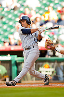 Daniel Gonzales-Luna #1 of the Rice Owls follows through on his swing against the Baylor Bears at Minute Maid Park on March 6, 2011 in Houston, Texas.  Photo by Brian Westerholt / Four Seam Images