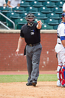 Home plate umpire Garrett Patterson asks for help on a check swing during the Southern League game between the Montgomery Biscuits and the Chattanooga Lookouts at AT&T Field on July 23, 2014 in Chattanooga, Tennessee.  The Lookouts defeated the Biscuits 6-5. (Brian Westerholt/Four Seam Images)