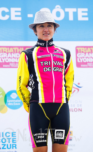 24 APR 2011 - NICE, FRA - Barbara Riveros Diaz (Tri Val de Gray) waits for the start of the prize giving ceremony after being first woman home at the  first round of the women's 2011 French Grand Prix triathlon series (PHOTO (C) NIGEL FARROW)