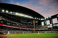 Apr. 23, 2012; Phoenix, AZ, USA; Arizona Diamondbacks outfielder Justin Upton (left) bats in the second inning against Philadelphia Phillies pitcher Kyle Kendrick at Chase Field. Mandatory Credit: Mark J. Rebilas-