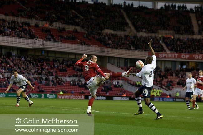Middlesbrough FC's Scottish international forward Kris Boyd in action against Preston North End's Leon Cort (right) in an Npower Championship fixture at the Riverside Stadium. The match ended in a one-all draw watched by a crowd of 16,157. Middlesbrough relocated from their former home at Ayresome Park in 1995.