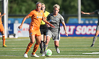 Sky Blue midfielder, Laura Kalmari (21), turns with the ball as Philadelphia midfielder, Joanna Lohman (17) applies pressure.  Philadelphia Independence defeated Sky Blue, 2-1, at John Farrell Stadium in West Chester, PA.
