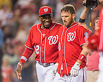 23 July 2016: Washington Nationals shortstop Stephen Drew is congratulated by manager Dusty Baker after Drew hits a pinch-hit walk-off triple, scoring Anthony Rendon in the bottom of the 9th inning, as the Nationals take the second game of their 3-game series 3-2 against the San Diego Padres at Nationals Park in Washington, DC. The win ties their series at one game apiece. Mandatory Credit: Ed Wolfstein Photo *** RAW (NEF) Image File Available ***