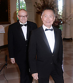 George Takei, right, and Brad Takei arrive for the State dinner in honor of Japanese Prime Minister Shinzo Abe and Akie Abe April 28, 2015 at the Booksellers area of the White House in Washington, DC. <br /> Credit: Olivier Douliery / Pool via CNP