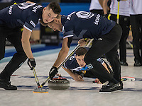 Glasgow. SCOTLAND. Scotland&quot;s Glen MUIRHEAH, watches hs &quot;Stone&quot; thought the legs and moving brushes of team mates {L} Hammy McMILLAN and {R} Ross PATERSON during the  &quot;Round Robin&quot; Game.  Scotland vs Italy at the Le Gruy&egrave;re European Curling Championships. 2016 Venue, Braehead  Scotland<br /> Wednesday  23/11/2016<br /> <br /> [Mandatory Credit; Peter Spurrier/Intersport-images]