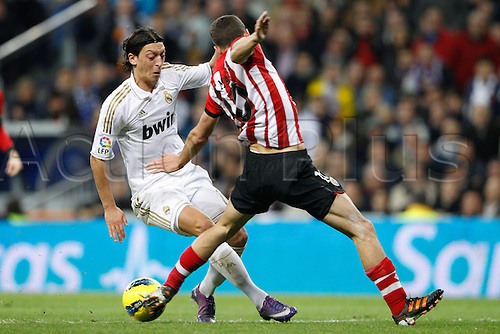 22.01.2012. Madrid Spain. La Liga  The match played between  Real Madrid and Athletic Club de Bilbao (4-1)  played at the Santiago Bernabeu Stadium.  Picture show Mesut Ozil (German midfielder of Real Madrid) and Oscar de Marcos Arana (Spanish forward of Athletic)