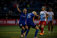 Seattle, WA - Wednesday, June 28, 2017: Jess Fishlock and Megan Rapinoe during a regular season National Women's Soccer League (NWSL) match between the Seattle Reign FC and the Chicago Red Stars at Memorial Stadium.
