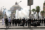 Egyptian security forces fire tear gas towards supporters of ousted President Mohammed Morsi during a demonstration outside Cairo University in Giza, near Cairo, May 20, 2014. Security forces used tear gas to disperse students who protested outside their campus Wednesday. Photo by Mohammed Bendari