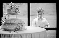 A boy eyes admires the wedding cake from the other sied of a window. (Photo by Scott Eklund/Red Box Pictures)