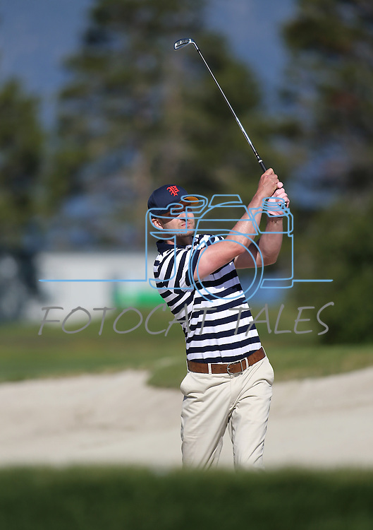 Justin Timberlake hits out of the sand during an American Century Championship practice round at Edgewood Tahoe Golf Course in Stateline, Nev., on Wednesday, July 15, 2015. <br /> Photo by Cathleen Allison