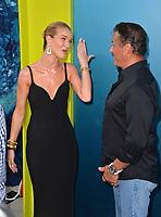 "LOS ANGELES, CA - August 06, 2018: Rosie Huntington-Whiteley & Sylvester Stallone at the US premiere of ""The Meg"" at the TCL Chinese Theatre"