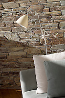 Natural materials such as linen and stone have been used to create a feeling of relaxed elegance