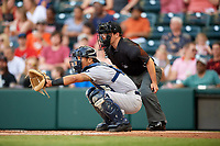 Trenton Thunder catcher Chance Numata (6) in front of home plate umpire Chris Scott during a game against the Richmond Flying Squirrels on May 11, 2018 at The Diamond in Richmond, Virginia.  Richmond defeated Trenton 6-1.  (Mike Janes/Four Seam Images)