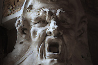 Head of a shouting satyr in carved stucco from the frame of the Danae fresco panels by Rosso Fiorentino, 1535-37, in the Galerie Francois I, begun 1528, the first great gallery in France and the origination of the Renaissance style in France, Chateau de Fontainebleau, France. The Palace of Fontainebleau is one of the largest French royal palaces and was begun in the early 16th century for Francois I. It was listed as a UNESCO World Heritage Site in 1981. Picture by Manuel Cohen