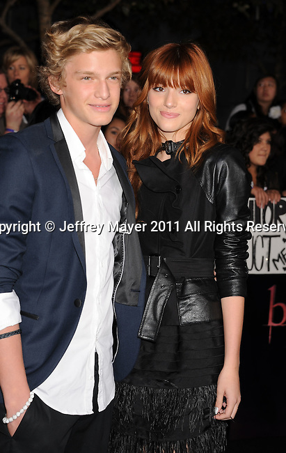 "LOS ANGELES, CA - NOVEMBER 14: Cody Simpson and Bella Thorne arrive at the Los Angeles premiere of ""The Twilight Saga: Breaking Dawn Part 1"" held at Nokia Theatre L.A. Live on November 14, 2011 in Los Angeles, California."