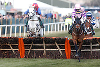 Zarkandar and Ruby Walsh (pink and purple) winning The John Smith's Aintree Hurdle from The New One (red), Aintree Racecourse, Aintree, Merseyside, England. April 4, 2013. Photo by i-Images/DyD Fotografos