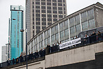 © Joel Goodman - 07973 332324. 24/03/2018. Birmingham, UK. FLA supporters drop a banner from a bridge in Birmingham City Centre during a demonstration by the Football Lads Alliance , against Islam and extremism . Offshoot group, The True Democratic Football Lads Alliance, also hold a separate demonstration . Photo credit : Joel Goodman