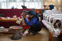 Yudon, wife of headmaster Nyima Wangdu, checks on her daughter Tenzin Dichen at home inside the campus of the School for the Blind in Tibet, in the capital city of Lhasa, September 2016.