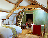 A partition was built in the main bedroom to create the second bedroom and a staircase constructed to replace the ladder that originally led down to the kitchen