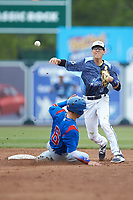 West Michigan Whitecaps shortstop Cole Peterson (19) makes a throw to first as Jhonny Bethencourt (6) of the South Bend Cubs slides into second base at Fifth Third Ballpark on June 10, 2018 in Comstock Park, Michigan. The Cubs defeated the Whitecaps 5-4.  (Brian Westerholt/Four Seam Images)