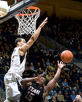 Justin Cobbs of California tries to block the ball during the game against Utah at Haas Pavilion in Berkeley, California on January 14th, 2012.  California defeated Utah, 81-45.