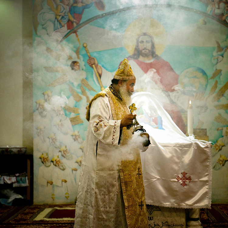 Egypt / Cairo / 6.1.2013 / Coptic Christmas celebrations at a cave chapel. The chapel is part of the Simon the Tanner Monastery, hidden in a cave in the Mokattam hills, above Cairo's Manshiyet Nasser (also known as Garbage City, Zabbaleen's settlement). © Giulia Marchi