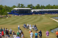 Tommy Fleetwood (ENG), Chris Paisley (ENG), Russell Knox (IRL), and Martin Laird (SCO) head down 18 during Round 4 of the Zurich Classic of New Orl, TPC Louisiana, Avondale, Louisiana, USA. 4/29/2018.<br /> Picture: Golffile | Ken Murray<br /> <br /> <br /> All photo usage must carry mandatory copyright credit (&copy; Golffile | Ken Murray)