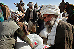 Hundreds of families from widely scattered villages gathered at a succession of locations in the northern Afghan province of Balkh to receive a second installment of food aid distributed by the International Committee of the Red Cross and the Afghan Red Crescent Society on Feb. 17 and 18, 2009. The aid was necessary to tide dry land farmers through to the next successful harvest after a series of drought years and harsh winters have left many on the verge of malnutrition and dislocation.