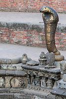 Bhaktapur, Nepal.  Naga, Sacred Cobra, at the Royal Bath, Naga Pokhari, 17th. Century.