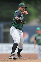 Augusta GreenJackets starting pitcher Edwin Escobar #22 attempts a pickoff throw during a game against the Asheville Tourists at McCormick Field Field on July 8, 2012 in Asheville, North Carolina. The Tourists defeated the GreenJackets 3-2. (Tony Farlow/Four Seam Images).