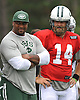 Marcel Shipp, New York Jets running backs coach, left, stands alongside quarterback #14 Ryan Fitzpatrick during team training camp at Atlantic Health Jets Training Center in Florham Park, NJ on Tuesday, Aug. 2, 2016.