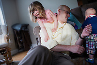 Fred Bermont plays with daughter Elyse Bermont (left, age 2.5) and son Dylan Bermont (age 9 months) in their home in Lexington, Massachusetts, USA, before he goes to work and drops the kids off at day-care on June 9, 2014. Bermont is the father of two children and shares parenting duties with his wife, Jen Bermont. Fred usually takes care of the morning routine, including feeding, dressing, and dropping the kids off at day-care, and Jen picks them up and watches over them in the afternoon. Fred is a Senior Clinical Standards Specialist at Shire, a pharmaceutical company with headquarters in Lexington.