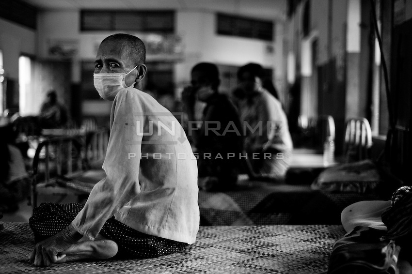 Elderly Cambodian female sitting the infectious disease ward. Resources on medical care of the elderly patients are seriously limited in Cambodia.