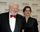 Theodore Bikel and a guest arrives for the formal Artist's Dinner honoring the recipients of the 2012 Kennedy Center Honors hosted by United States Secretary of State Hillary Rodham Clinton at the U.S. Department of State in Washington, D.C. on Saturday, December 1, 2012. The 2012 honorees are Buddy Guy, actor Dustin Hoffman, late-night host David Letterman, dancer Natalia Makarova, and the British rock band Led Zeppelin (Robert Plant, Jimmy Page, and John Paul Jones).  Mr. Bikel passed away in Los Angeles on Tuesday, July 21, 2015 at the age of 91.<br /> Credit: Ron Sachs / CNP