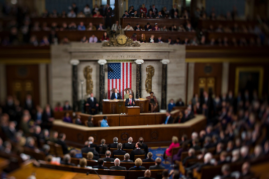 Vice President Joe Biden (L) and Speaker of the House Nancy Pelosi applaud as U.S. President Barack Obama addresses a joint session of Congress in the House Chamber of the Capitol in Washington...Photo by Brooks Kraft/Corbis.......................