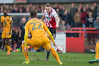 James Dayton of Cheltenham Town shoots at goal during the Sky Bet League 2 match between Cheltenham Town and Cambridge United at the LCI Stadium, Cheltenham, England on 18 March 2017. Photo by Mark  Hawkins / PRiME Media Images.