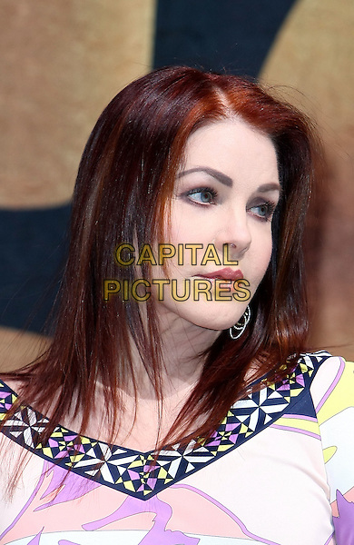 "PRISCILLA PRESLEY.Cirque Du Soleil unveils ""Viva Elvis"" at Aria Resort and Casino at City Center, Las Vegas, Nevada, USA..December 15th, 2009.headshot portrait pink white yellow pattern pucci black plastic surgery .CAP/ADM/MJT.© MJT/AdMedia/Capital Pictures."