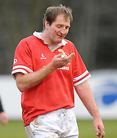 Gary Longwell is in the wars during the charity match between the Ulster 1999 XV and a Wooden Spoon Select XV at Shaw's Bridge Belfast.  Mandatory Credit - Photo : Oliver McVeigh