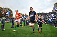 Charlie Ewels of Bath Rugby, mascot in hand, leads his team out onto the field. European Rugby Champions Cup match, between Bath Rugby and Benetton Rugby on October 14, 2017 at the Recreation Ground in Bath, England. Photo by: Patrick Khachfe / Onside Images