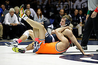 STATE COLLEGE, PA - FEBRUARY 16: David Taylor of the Penn State Nittany Lions during a 165 pound match against Tyler Caldwell of the Oklahoma State Cowboys on February 16, 2014 at Rec Hall on the campus of Penn State University in State College, Pennsylvania. Penn State won 23-12. (Photo by Hunter Martin/Getty Images) *** Local Caption *** David Taylor;Tyler Caldwell