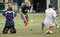 Mike Golic Jr. runs the drill.