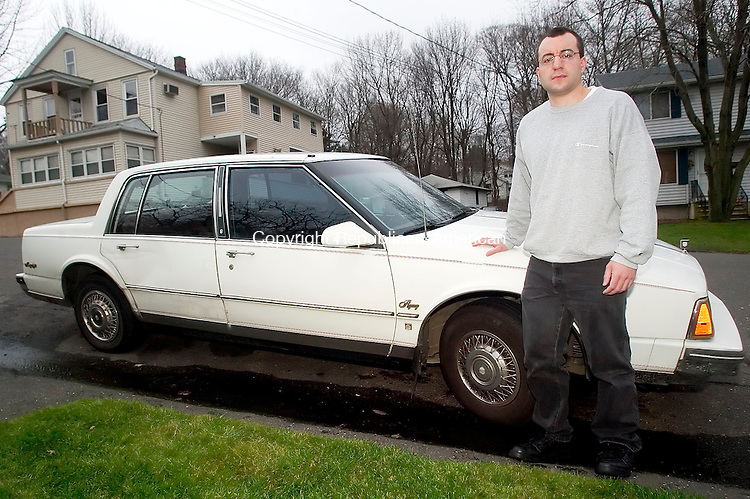 WATERBURY, CT- 15 NOV 06- 111506JT02- <br /> Jason Carlascio stands with his 1985 Oldsmobile 98 on Wednesday, Nov. 15.<br /> Josalee Thrift Republican-American