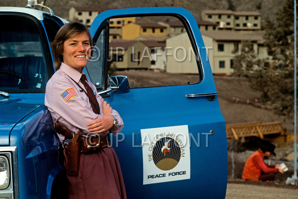 Wasco, Oregon, January 1984: Ma Deva Barkha, the police chief of the peace force of the city of Rajneeshpuram. Five of the six members of the Rajneeshpuram police are disciples of Bhagwan Rajneesh. Rajneeshpuram, was an intentional community in Wasco County, Oregon, briefly incorporated as a city in the 1980s, which was populated with followers of the spiritual teacher Osho, then known as Bhagwan Shree Rajneesh. The community was developed by turning a ranch from an empty rural property into a city complete with typical urban infrastructure, with population of about 7000 followers.