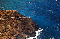 Makapu'u Lighthouse, a familiar O'ahu landmark, perched on a cliff above crashing waves