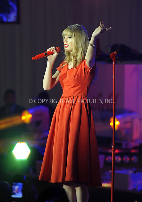 WWW.ACEPIXS.COM....US Sales Only....Taylor Swift performing at the Westfield London Christmas Lights ceremony on November 6 2012  in London....By Line: Famous/ACE Pictures......ACE Pictures, Inc...tel: 646 769 0430..Email: info@acepixs.com..www.acepixs.com