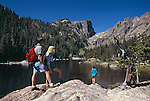 Family of four on a hike at Dream Lake on summer day, Rocky Mtn Nat'l Park, CO